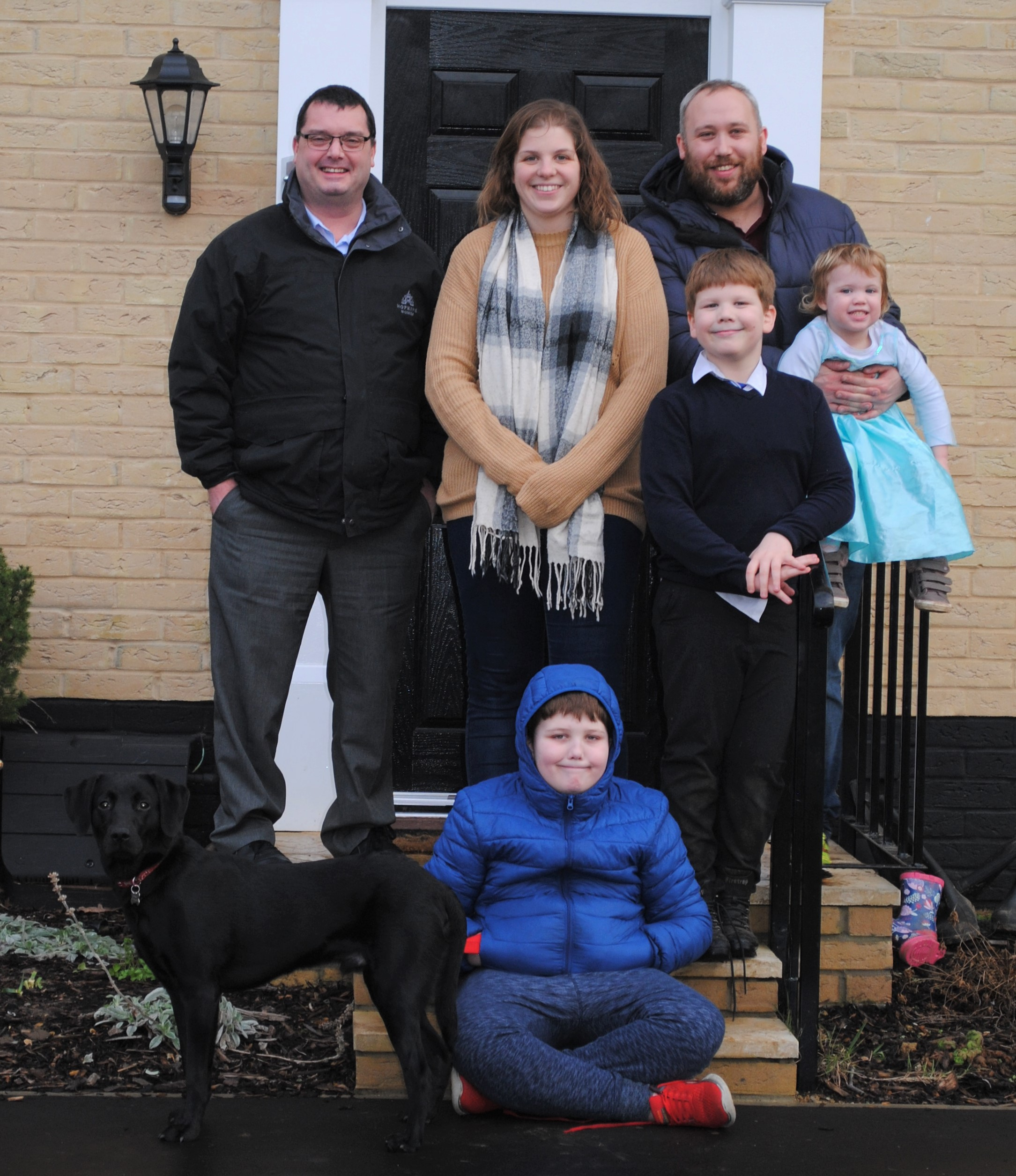 Nikki and Liam with children, dog and Shaun Tate of Hopkins Homes (left)
